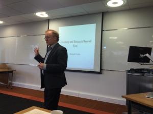 A photo of Professor Michael Clarke presenting